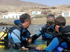 Practicing skills in the calm waters close to the beach as part of a PADI diving course in Gran Canaria