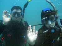 A Father and son practice their signals together (well .. nearly)