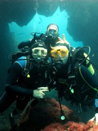 Two divers watch the smaller fish in the Marine Reserve in Gran Canaria