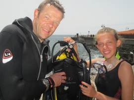 Father and Daughter divers compare their guages to check their equipment.